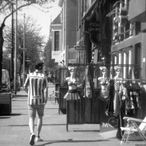 black and white picture of man and mannequins